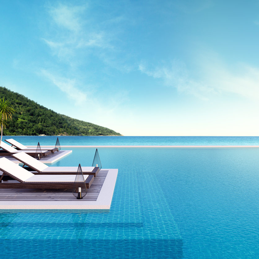 Beach lounge sun loungers on Sunbathing deck and private swimming pool with panoramic sea view at luxury villa/3d rendering