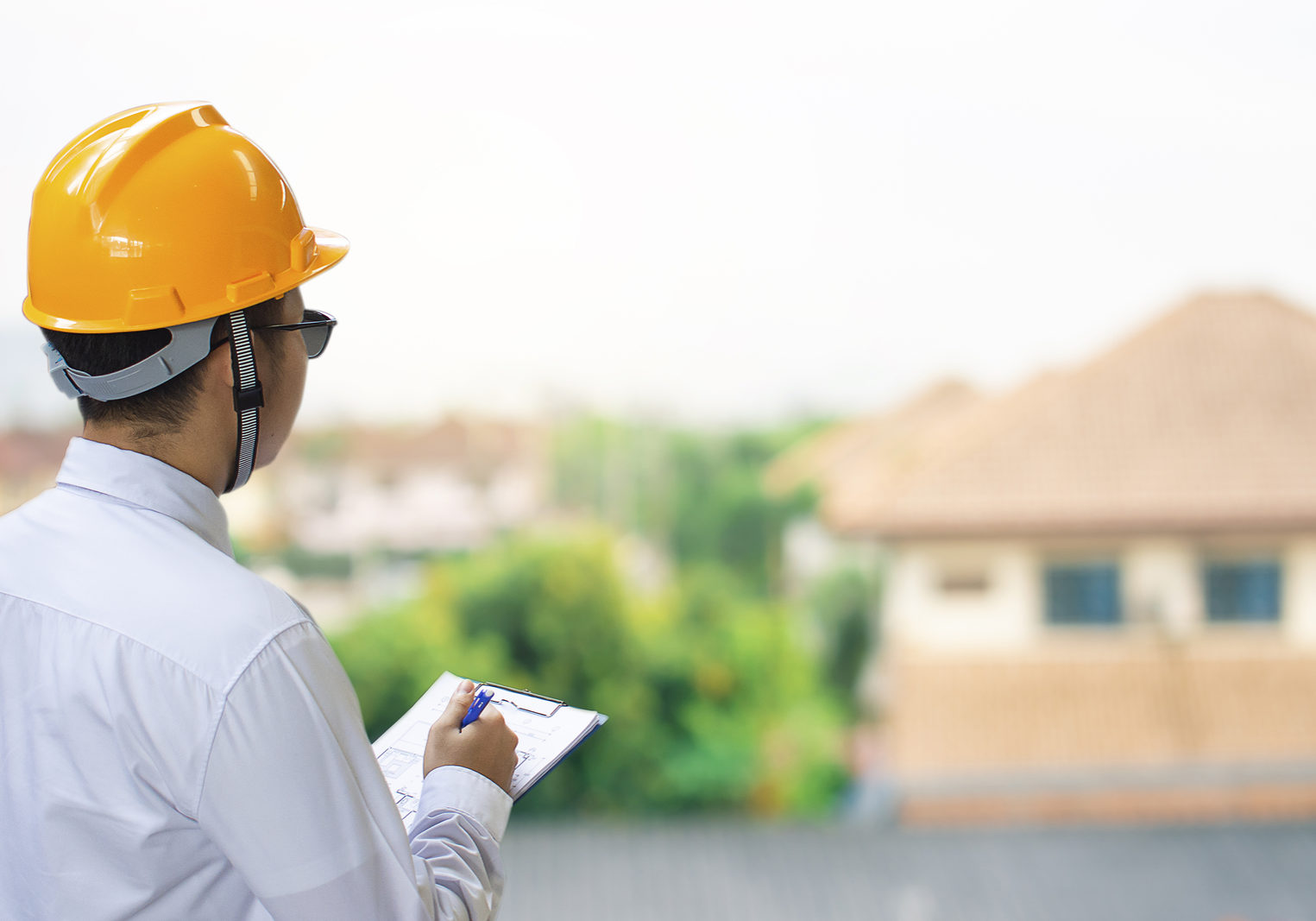 Male engineer inspection checking in home With note on notepad or home blurred background.Metaphor Quality inspection or Production speed For the best quality to customers.